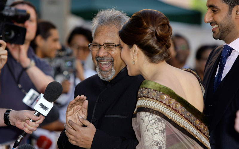 Indian director Mani Ratnam, centre left, reacts with Indian actress Aishwarya Rai Bachchan, on the red carpet for the World Premiere of the film Raaven, at the BFI, British Film Institute, in London, Wednesday, June 16, 2010. (AP)
