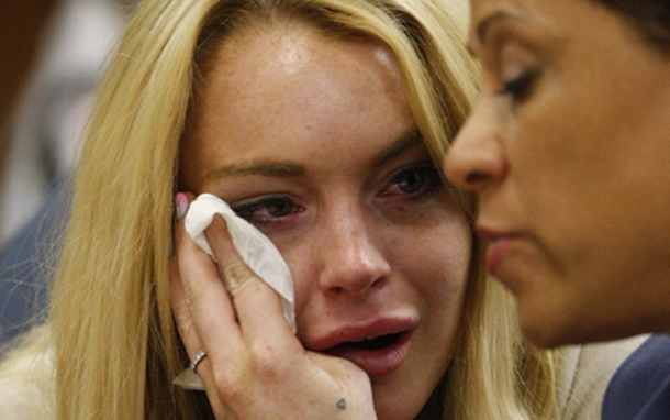 Lindsay Lohan (L) cries next to her lawyer Shawn Chapman Holley as she is sentanced to 90 days jail by Judge Marsha Revel during her hearing at the Beverly Hills Courthouse. Troubled Hollywood starlet Lindsay Lohan broke down in tears after she was sentenced to 90 days in jail for violating her probation in two 2007 drunk driving cases. The actress, once a red-headed Disney films star and promising A-lister whose career since has spun off course, also was ordered to participate in a 90-day inpatient substance abuse program. After Beverly Hills Superior Court Judge Marsha Revel sentenced Lohan, 24, the actress and fashion muse wept in court. (AFP)