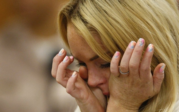 Lindsay Lohan cries as she is sentenced to 90 days jail by Judge Marsha Revel during her hearing at the Beverly Hills Courthouse. Troubled Hollywood starlet Lindsay Lohan broke down in tears after she was sentenced to 90 days in jail for violating her probation in two 2007 drunk driving cases. The actress, once a red-headed Disney films star and promising A-lister whose career since has spun off course, also was ordered to participate in a 90-day inpatient substance abuse program. After Beverly Hills Superior Court Judge Marsha Revel sentenced Lohan, 24, the actress and fashion muse wept in court. (AFP)