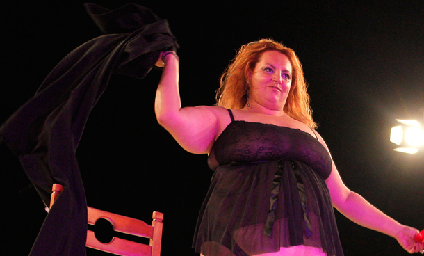 """A candidate at the 21st Italian national Miss Cicciona (Miss Fat Woman) contest. The annual event celebrates men and women over a """"certain weight"""", organisers said. (AFP)"""
