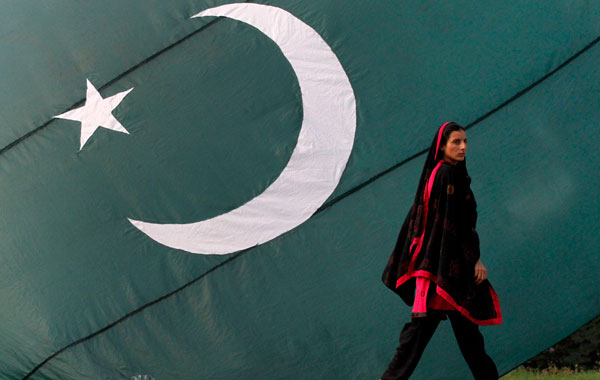 Pakistan Independence Day A woman walks past a Pakistan national flag on  display at a sidewalk in Lahore on the eve of the nation's Independence  Day. (REUTERS) Pakistani Navy cadets parade at the mausoleum of the father  of nation Quaid-e-Azam ...