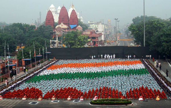 School children in coloured clothes form India's flag as they participate in a full-dress rehearsal for the country's Independence Day celebrations at the historic Red Fort in Delhi. (REUTERS)