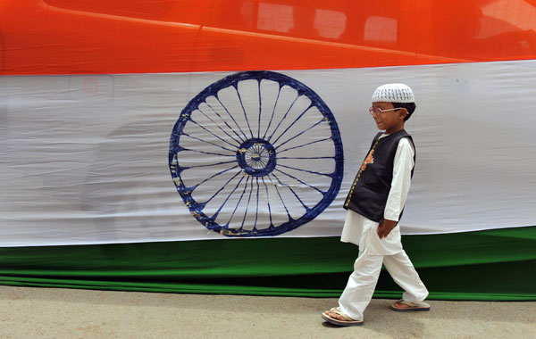 A Muslim Indian boy walks past a 400-metre long national flag set up ahead of Independence Day in Hyderabad. (AFP)