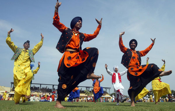 Indian school boys perform 'Bhangra', the folk dance from the state of Punjab as they take part in full dress rehearsal for India's Independence Day celebrations and parade in Amritsar, India. (EPA)