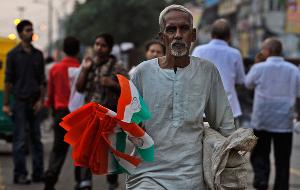 A man sells Indian national flags on the eve of Independence Day, in New Delhi, India. (AP)