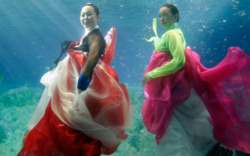 Models show off traditional Korean dress Hanbok, a creation by designer Park Sul-nyeo, during the Underwater Hanbok fashion show in Seoul, South Korea, Sunday. (AP)