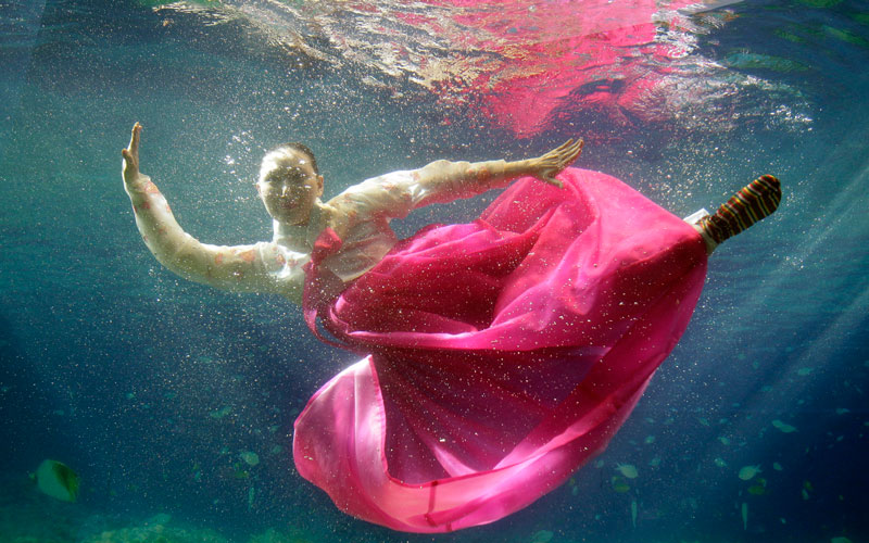 A model wears the South Korean traditional dress Hanbok, a creation by designer Park Sul-nyeo, during an underwater Hanbok fashion show in Seoul, South Korea, Sunday. (AP)
