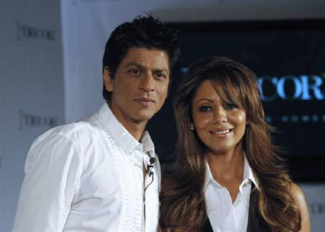 Bollywood actor Shah Rukh Khan (L) and his wife Gauri pose for a picture after a news conference in Mumbai. (REUTERS)