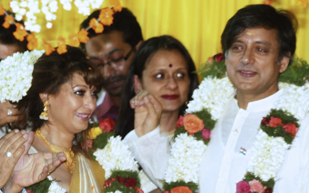A file picture of India's former Minister of State for External Affairs Shashi Tharoor arrived in Dubai along with his wife Sunanda Pushkar for the second leg of their wedding celebrations. (AFP)