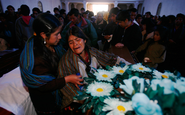Quiche indigenous women grieve during a funeral mass for mudslide victims in Santa Maria Ixtahuacan, Guatemala. Torrential rains from a tropical depression caused landslides that have killed at least 38 people in Guatemala. (AP)