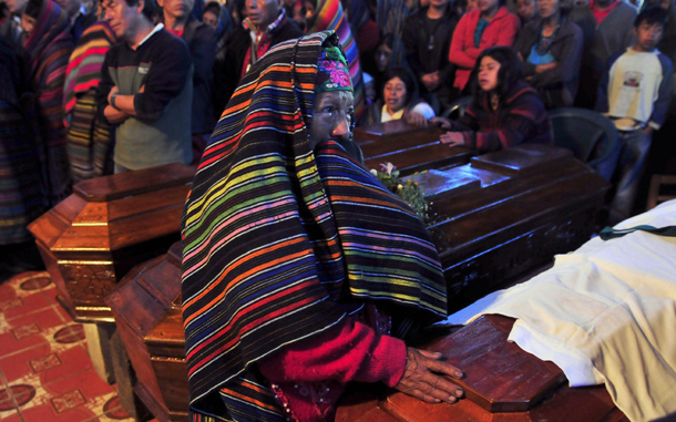 A woman cries next to a coffin of one of the victims of the strong rains that hit Guatemala at the church of Santa Catarina Ixtahucan, Guatemala. At least 37 died due to the rains in two days, at least 40 are missing and more than 40,000 were affected. (EPA)