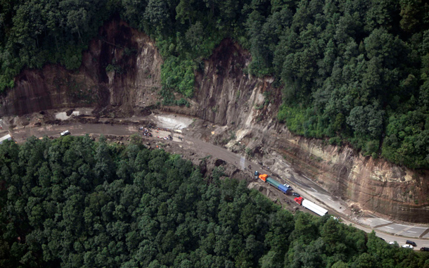 An aerial view shows the site of a landslide in La Cumbre de Alaska. As many as 100 people may have been buried in a landslide in Guatemala on a major highway, a spokesman for the fire department said on Sunday. Approximately 100 people were attempting to dig a bus out of a first mudslide when a second engulfed the scene, said fire department spokesman Sergio Vasquez. (REUTERS)