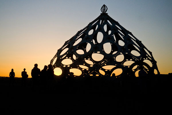 Burners greet the sun as it rises over Black Rock City, Nev. during Burning Man 2010. For one week out of the year, a portion of the Black Rock Desert is transformed into a thriving diverse city known as Black Rock City. (AP)