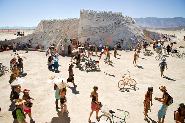 """Burners congregate around """"The Temple of Flux,"""" a spiritual place for many at Burning Man 2010 in Black Rock City, Nev. (AP)"""
