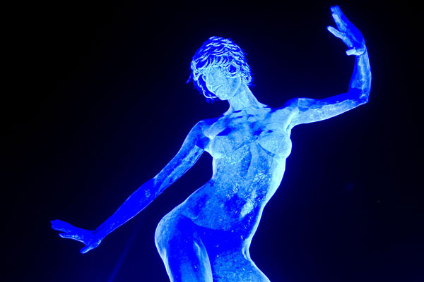 """Attendees admire Marco Cochrane's """"Bliss Dance"""" during Burning Man 2010 in Black Rock City, Nev. (AP)"""