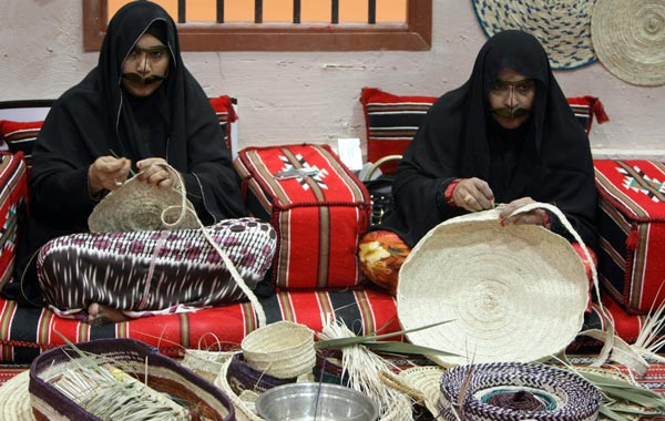 Emirati women demonstrate traditional crafts at the Abu Dhabi International Hunting and Equestrian exhibtion (ADIHEX). (AFP)