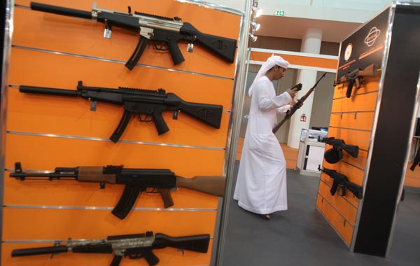 An Emirati looks at a display of hunting guns on  the first day of the Abu Dhabi International Hunting and Equestrian exhibtion (ADIHEX). (AFP)