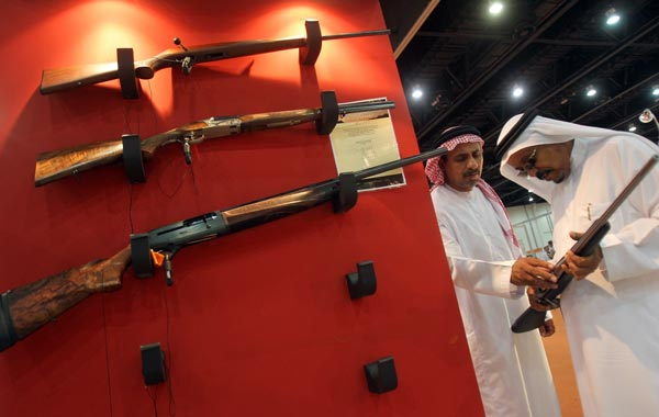 Emiratis look at a display of hunting guns on the first day of the Abu Dhabi International Hunting and Equestrian exhibtion (ADIHEX). (AFP)