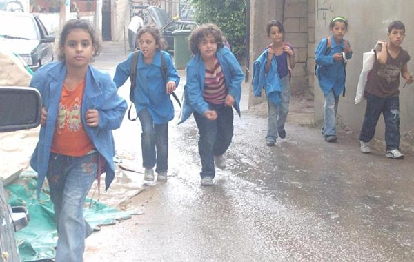 For these children running around Mieh Mieh, a life in refugee camps is all they have ever known (SUPPLIED)