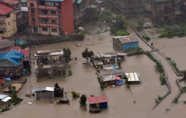 A general view shows houses submerged by flooding due to heavy rains brought by Typhoon Megi in Baguio City, Benguet province, north of Manila. (AFP)