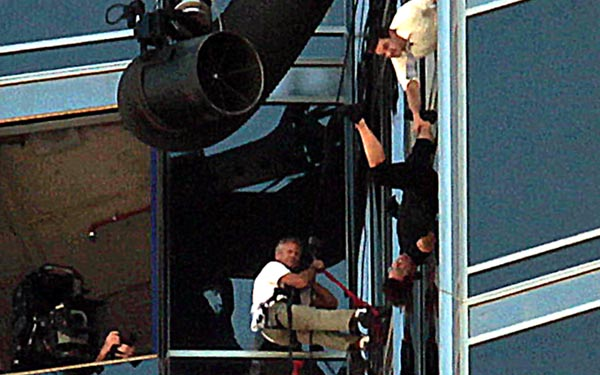 Tom Cruise dangles out of a window of the Burj Khalifa while Jeremy Renner attempts what looks like a rescue as filming continues for 'Mission Impossible -- Ghost Protocol' on Wednesday, November 3 (PATRICK CASTILLO)