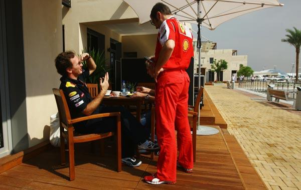 Red Bull Racing Team Principal Christian Horner (L) talks with Ferrari Team Principal Stefano Domenicali (R) before practice for the Abu Dhabi Formula One Grand Prix at the Yas Marina Circuit in Abu Dhabi, United Arab Emirates. (GETTY)