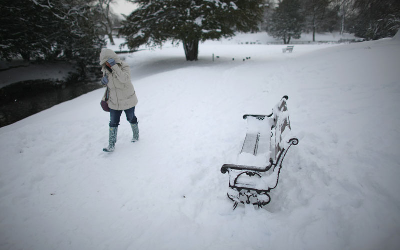 A woman makes her way through the snow in Buxton's Pavilion Gardens on November 30, 2010 in Buxton, United Kingdom. The peak district town of Buxton in Derbyshire remains virtually cut off  by overnight snow fall as freezing weather conditions and snow has created chaos in Scotland and Northern England and is now moving south to the capital. (GETTY IMAGES)