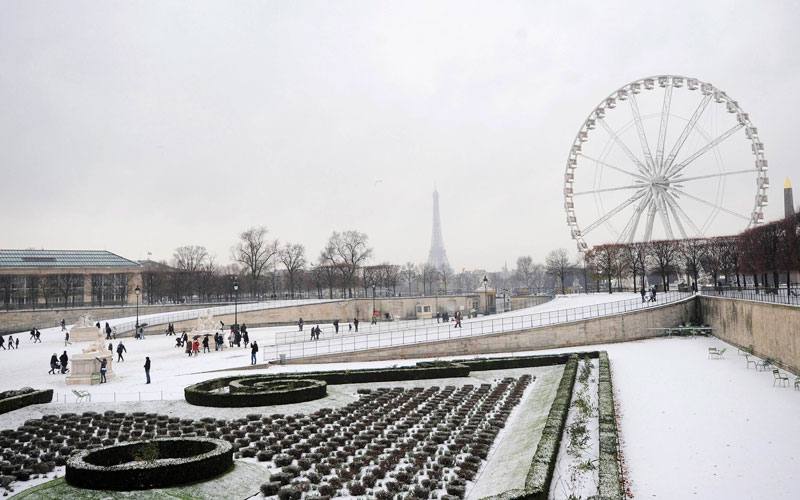 People walk in the snow-covered Tuileries gardens in Paris as winter weather and sub-freezing temperatures continue in France December 4, 2010. The Eiffel Tower is seen in the background.    (REUTERS)