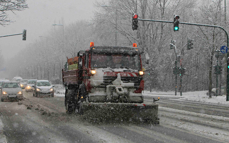 A snow plough clears a road near the western German city of Leverkusen December 5, 2010.   (REUTERS)