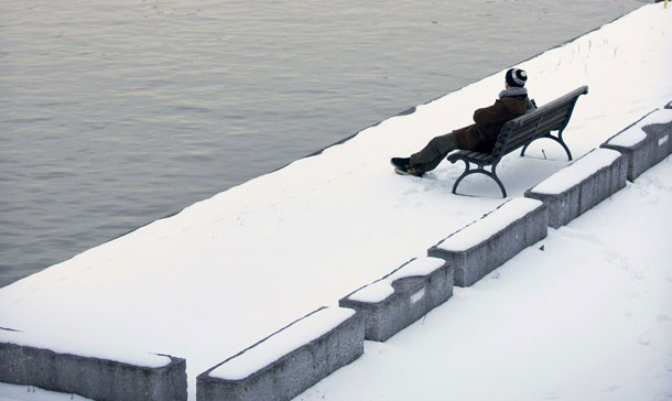A lone man sits on a bench in the snow on the bank of river Spree in Berlin. After a week of snow and zub zero tempratures in the German capital the milder weather saw the snow start to melt away. (AFP)