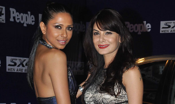 Indian models (L/R) Candice Pinto and Anchal Kumar arrive to attend a People Magazine theme party in Mumbai. (AFP)