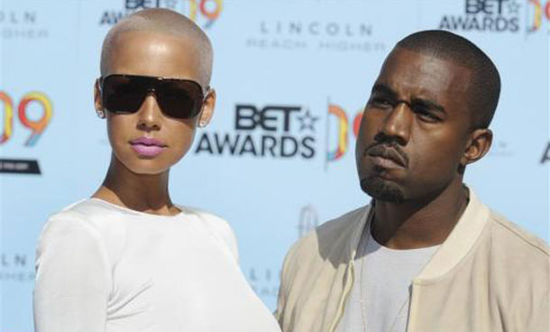Kanye West poses with Amber Rose while arriving at the BET Awards '09 in Los Angeles. (REUTERS)