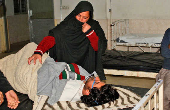 A Pakistani woman comforts a man who was shocked as a severe earthquake hit the area, in a hospital in Quetta, Pakistan. A major 7.2 magnitude earthquake rocked area of southwestern Pakistan early Wednesday, shaking many parts of the country and causing tremors as far away as India and the United Arab Emirates.(AP)