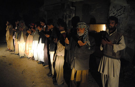 People of Jafarabad, 300 kilometers north of Quetta, Pakistan praying outside their homes as a severe earthquake hits the area on Wednesday. A major 7.2 magnitude earthquake rocked area of southwestern Pakistan early Wednesday, shaking many parts of the country and causing tremors as far away as India and the United Arab Emirates. (AP)