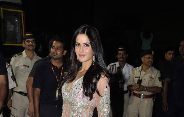 Katrina Kaif in a beautiful peachish pink lehenga and long net coat with silver work. (AGENCIES)