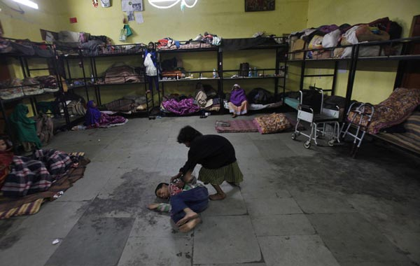 Homeless children play inside a shelter for homeless women and children managed by a non-governmental organisation (NGO) in New Delhi December 28, 2010. An intense spell of cold weather has forced hundreds of homeless to seek refugee in the shelters. Temperatures have dipped to 3.7 Celsius degrees (38.66 Fahrenheit) and reports say at least two people in the capital have died so far this winter. (REUTERS)