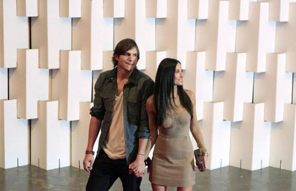 Actor Ashton Kutcher and actress Demi Moore arrive for Colcci's Winter 2011 collection during Sao Paulo Fashion Week. (REUTERS)