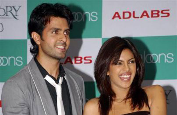 "Bollywood actors Priyanka Chopra (R) and Harman Baweja smile during the promotional event of their forthcoming movie ""Love Story 2050"" in Mumbai June 28, 2008. (REUTERS)"