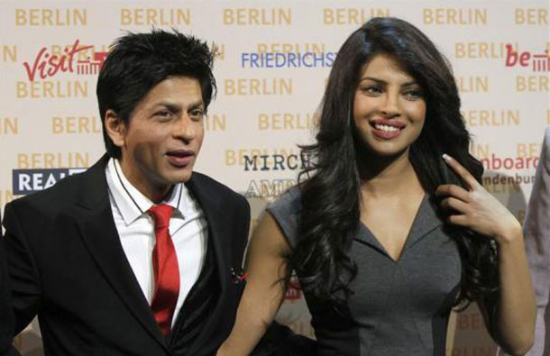 "Indian actor Shah Rukh Khan (L) and actress Priyanka Chopra poses during a photocall to promote their movie ""Don-2"" in Berlin, October 22, 2010. (REUTERS)"