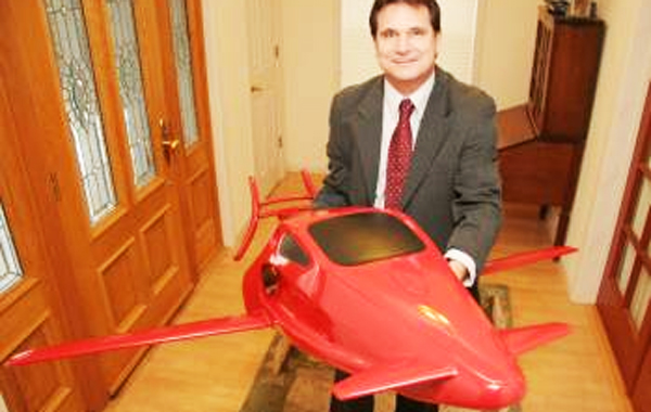 Meadow Vista resident Sam Bousfield stands with the model of his Switchblade flying car. (AGENCIES)