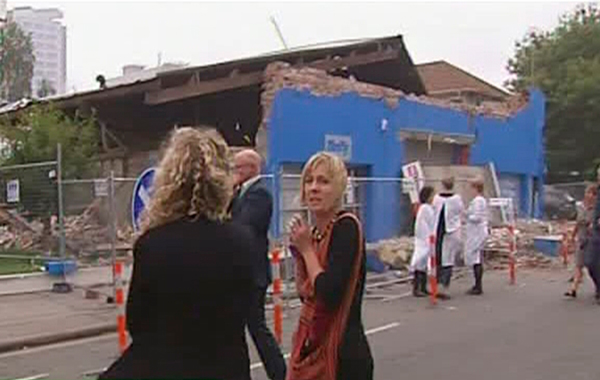 People react as they look at a collapsed building after an earthquake in Christchurch, New Zealand. (REUTERS)