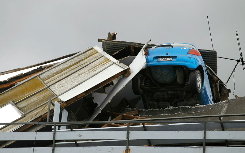 A smashed car is seen in a car parking building on February 22, 2011 in Christchurch, New Zealand. The 6.3 magnitude earthquake - an aftershock of the 7.1 magnitude quake on September 4 - struck 20km southeast of Christchurch at around 1pm local time, with initial reports suggesting damage and fatalities far exceeding the initial quake.  (GETTY IMAGES)