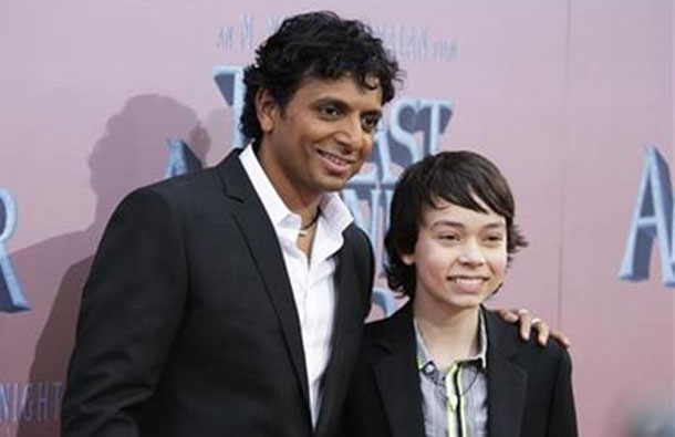 "Director M. Night Shyamalan (L) and cast member Noah Ringer pose as they arrive for the premiere of the film ""The Last Airbender"" in New York. (REUTERS)"