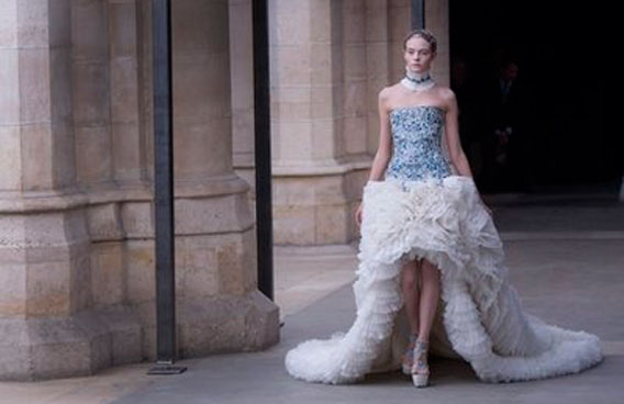 A model shows a creation from designer Sarah Burton of Alexander McQueen as part of the Fall-Winter, ready-to-wear 2012 fashion collection, during Paris Fashion week. (AP)