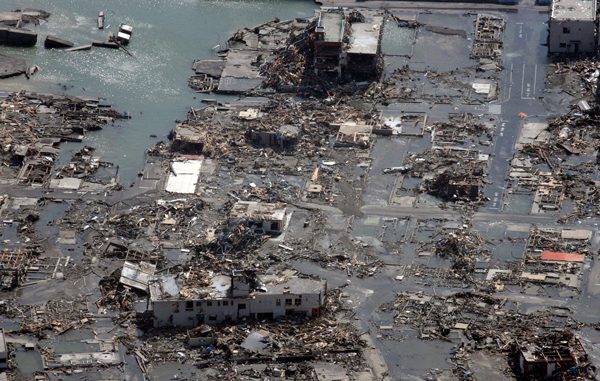 This aerial view taken on March 14, 2011 during an AFP-chartered flight shows an area destroyed by the tsunami in Minamisanriku in Miyagi prefecture three days after a massive 8.9 magnitude earthquake and tsunami devastated the coast of eastern Japan. A new explosion at a nuclear plant in nearby Fukushima prefecture hit punch-drunk Japan on March 14 as it raced to avert a reactor meltdown after a quake-tsunami disaster that is feared to have killed more than 10,000 people. (AFP)