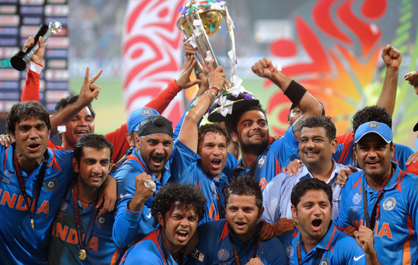 Indian cricketers pose with the trophy as they celebrate after beating Sri Lanka in the ICC Cricket World Cup 2011 final match at The Wankhede Stadium in Mumbai. (AFP)