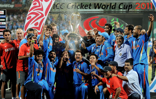 Indian cricketers celebrate with the trophy after beating Sri Lanka in the ICC Cricket World Cup 2011 final match at The Wankhede Stadium in Mumbai. (AFP)