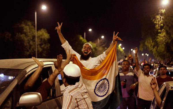 Indian cricket fans celebrate after their team won the Cricket World Cup final against Sri lanka, in New Delhi, India. (AP)