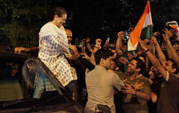 India's ruling United Progressive Alliance Chairperson Sonia Gandhi greets a crowd of Indian cricket fans after their team won the Cricket World Cup final against Sri lanka, in New Delhi, India. (AP)