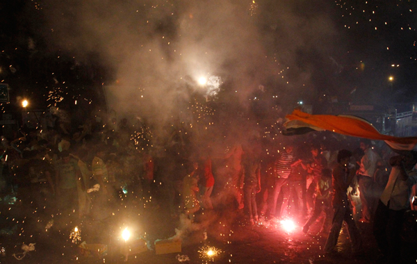 Cricket fans celebrate in Delhi, after India won the ICC Cricket World Cup final match against Sri Lanka. (REUTERS)
